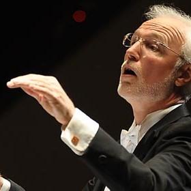 Professor Thomas Evans conducting at a performance.